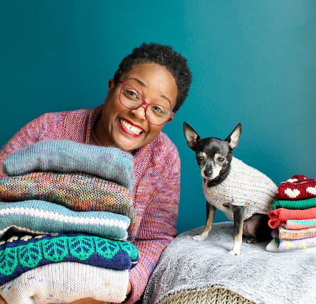 Dana and Jellybean and their hand knit sweaters