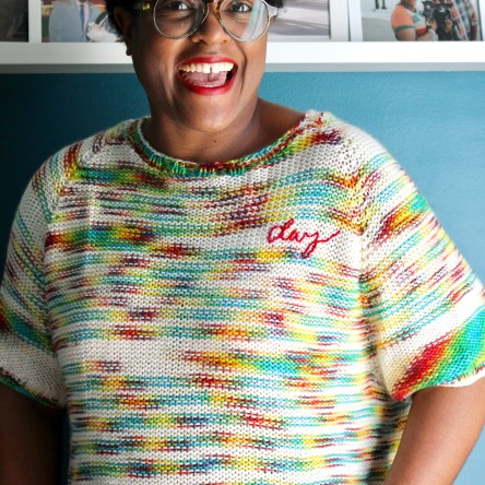 DWJ in a custom rainbow knit with embroidery