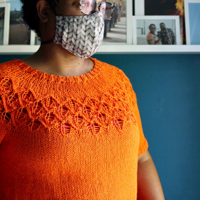 DWJ wearing a cotton Love Note sweater and face mask