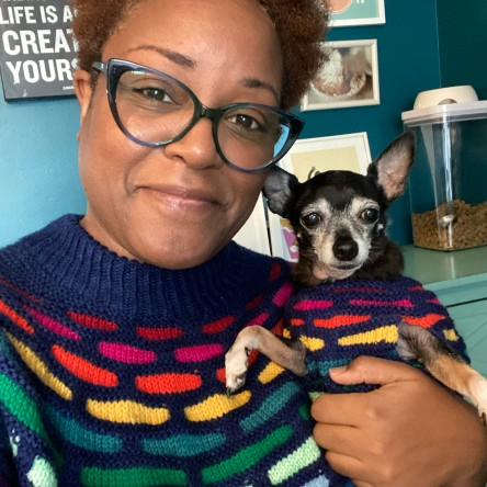 Dana and Jellybean in matching rainbow sweaters