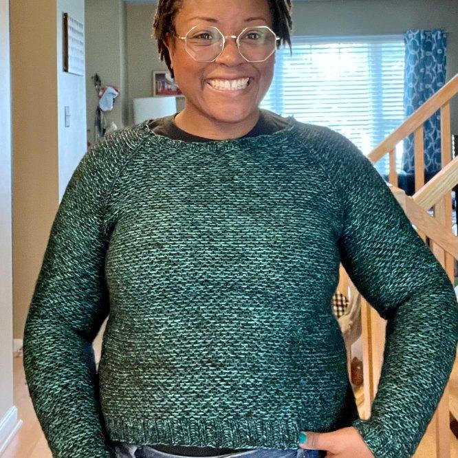 DWJ in her green Nurtured sweater